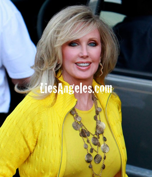 Morgan Fairchild in yellow